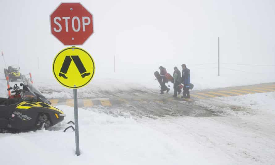 Snowboarders return to the ski tube after fresh snowfalls and a complete white out at Persher ski fields