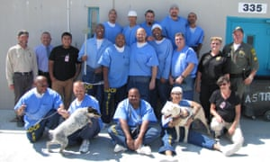 Inmates at the California State Prison, Los Angeles, participating in the Paws for Life program.