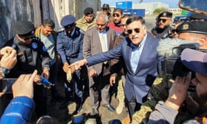 Fayez al-Sarraj, the prime minister of Libya's UN-recognised Government of National Accord, visits the port in the capital Tripoli after it was hit by rocket fire on 20 February.