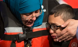 Yusuf, a Syrian refugee, is comforted by his mother Fatma after they were stopped by the Turkish coastguard off Çeşme.