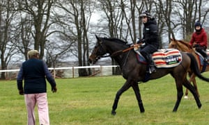 Nicky Henderson with Altior and Nico de Boinville after early morning gallops in Lambourn on Saturday.