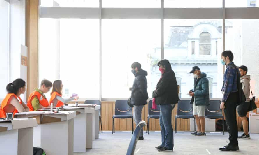 People wait to cast their votes for the 2020 General Election in Auckland, New Zealand