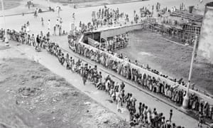Indian citizens waiting in line at a soup kitchen