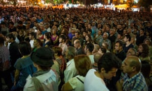 Large crowds were still gathering on the streets of Yerevan on Sunday night before the gunman surrendered. Local media reported that they downed tools after the security services deployed armoured vehicles to breakdown their barricade