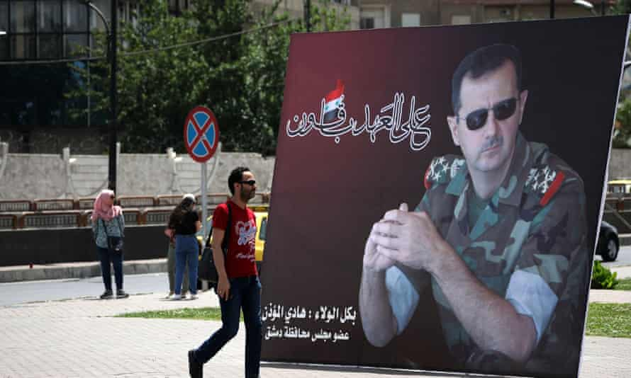 Poster of the Syrian president, Bashar al-Assad in combat dress