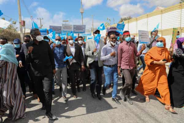 Former prime minister Hassan Ali Khaire, centre, joins members of opposition parties as they protest against the political impasse in Mogadishu, 19 February 2021.