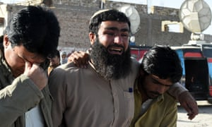 Pakistani relatives mourn the loss of family members in Quetta after an attack on the city's police training college