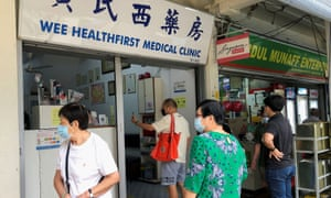 People queue to enquire about Sinovac vaccine at a clinic in Singapore on June 18.