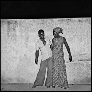 Les jeunes danseurs de Sikasso Sira, 1972 This was shot in a popular Bobo neighborhood called Sikasso Sira, where many Malians people lived. I would imagine this was a young Malian couple dating and preparing for a dance. I would often go to that place as this white wall was a perfect scene for me to shoot dancers and lovers