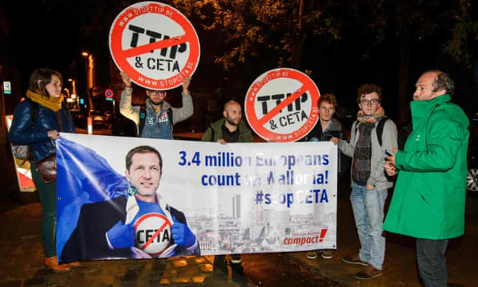Protesters hold up a placard reading '3.4 million Europeans count on Wallonia – stop Ceta' outside a meeting at the Walloon parliament in Namur, Belgium.
