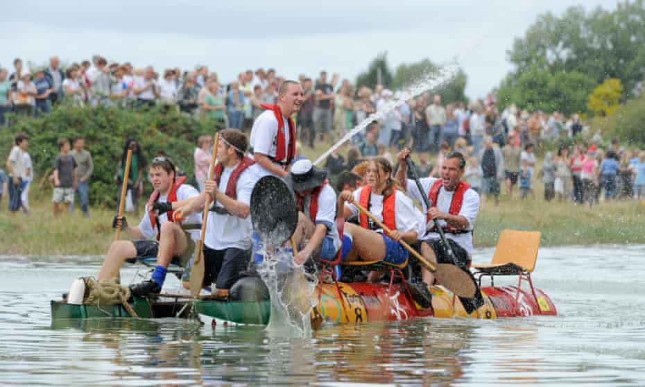 Competitors race downriver from Lewes to Newhaven on homemade craft.