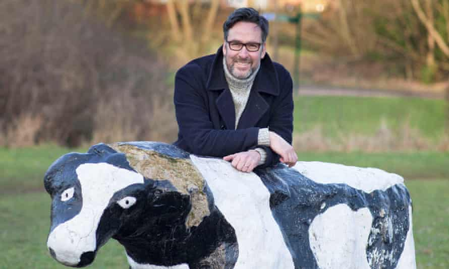 Richard Macer with concrete cow.