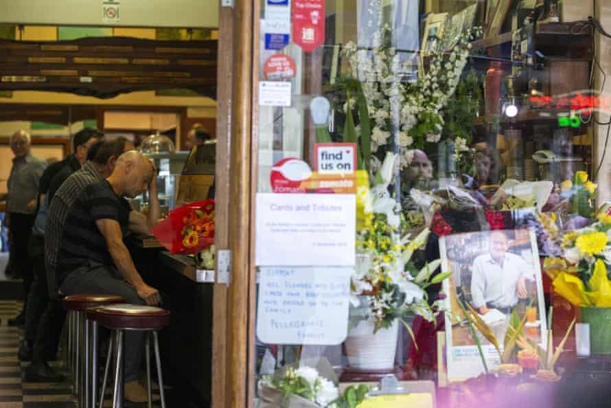 Customers drink coffee inside Pellegrini's Espresso Bar.