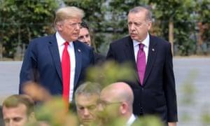 Trump walked to the family photo with Turkish president Recep Tayyip Erdoğan.