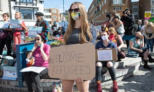 Hope Jackson and fellow pro-refugee demonstrators rally in Dover town centre, protesting against the presence of anti-immigrant, far-right groups.