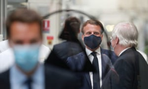 The French president, Emmanuel Macron, wears a mask as he visits a car factory in Étaples, France, to discuss his coronavirus recovery plan.
