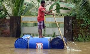 A man rides a makeshift raft in Kochi, Kerala state.