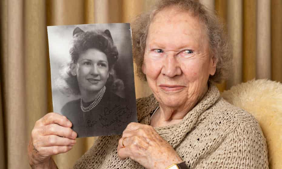 Margaret Ford holds a picture of herself when she was 18, taken in 1945