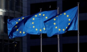 European union flags fly outside the European commission headquarters in Brussels, Belgium.