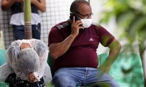 Relatives of a coronavirus victim react at the Dr João Lucio Pereira Machado hospital in Manaus last week.