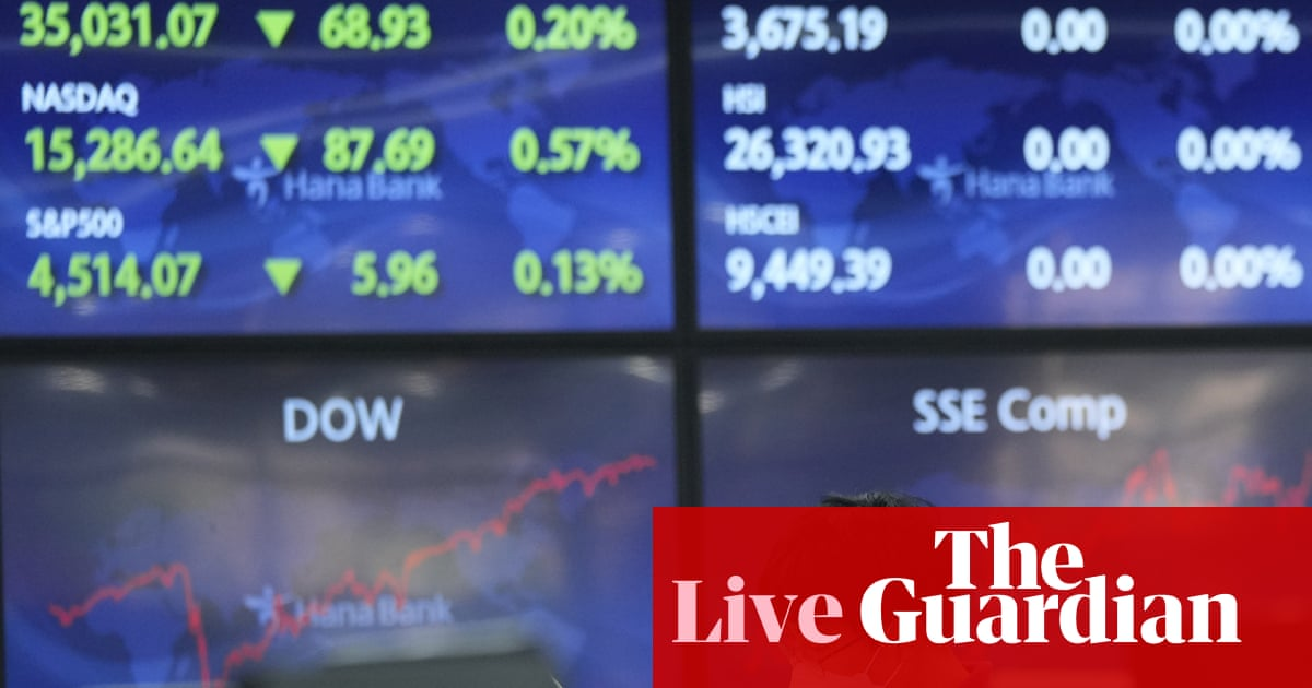 Growth worries hit markets as Fed signals 'downshift' in US economy – business live