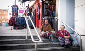 Two women sit on street steps in Aldershot, which forms part of Rushmoor in Hampshire
