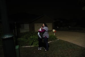 Kylie McGill hugs Eliza waiting for the for the dawn service broadcast to begin.