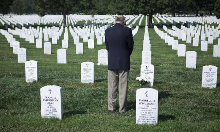 Khizr Khan pauses at the grave of his son Army Captain Humayun Saqib Muazzam Khan in Arlington national cemetery.
