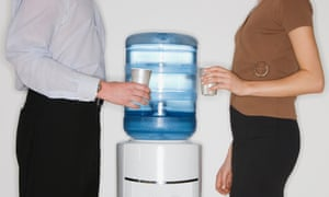Office workers next to watercooler