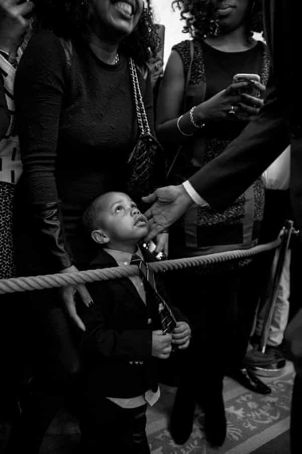 Obama greets a young guest at the White House in February 2016.