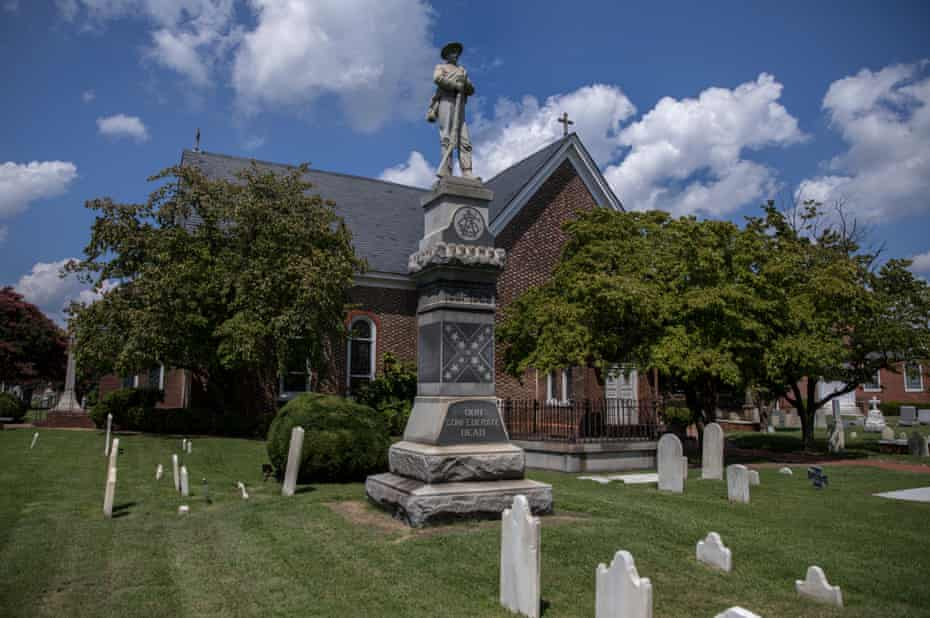 A Confederate statue in the center of a cemetery at St John's Episcopal Church in downtown Hampton, Virginia.