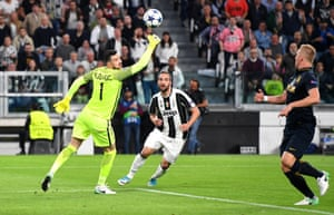 Gonzalo Higuain dinks the ball over Danijel Subasic but Glik tracks back to clear.
