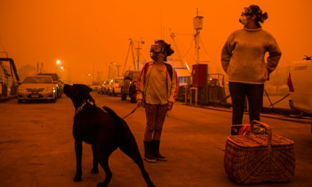 Residents of Eden, NSW, prepare to shelter from fires aboard a boat, January 2020
