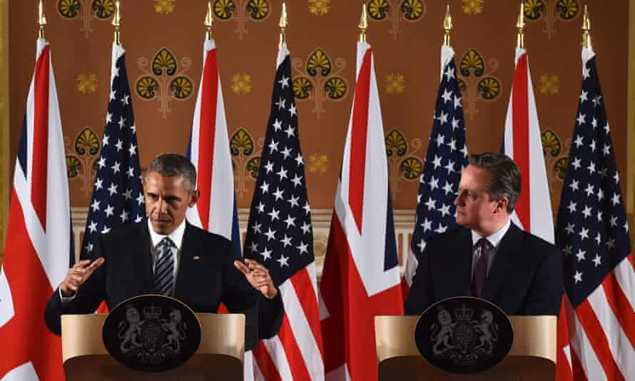 Barack Obama (L) and David Cameron hold a press conference at the Foreign and Commonwealth Office in central London.