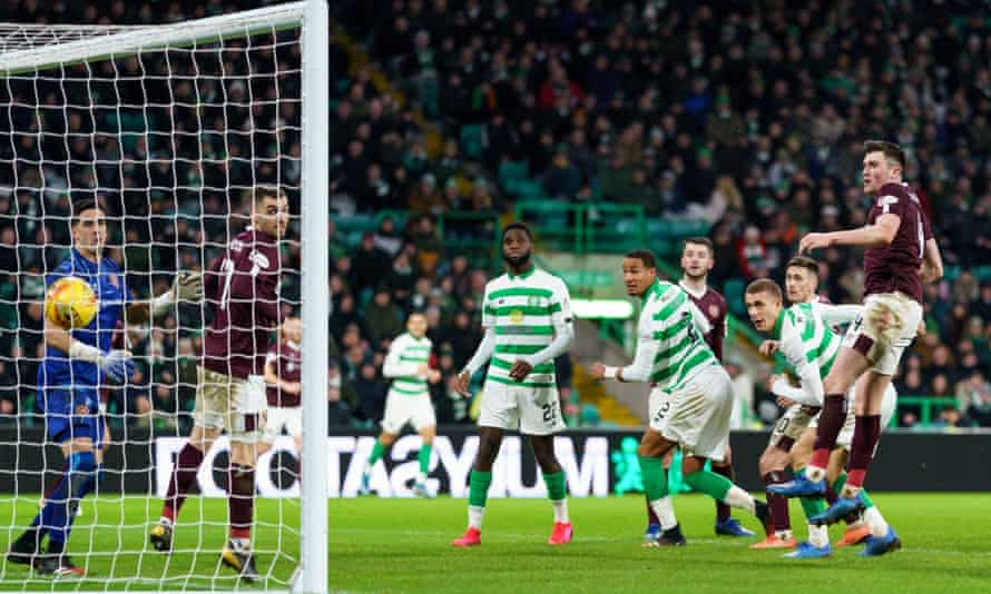 Celtic's Jozo Simunovic scores their fifth goal against Hearts.