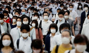 People wearing protective masks amid the coronavirus disease outbreak, make their way during rush hour at a railway station in Tokyo, Japan, 3 July 2020.