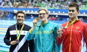 Bronze medalist Gabriele Detti, gold medalist Mack Horton, silver medalist Sun Yang pose during the medal ceremony for the Men's 400m Freestyle at the Rio 2016 Olympic Games.