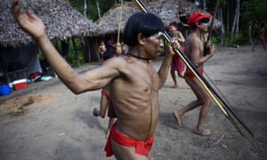 Yanomami natives perform a ritual dance by the Brazil-Venezuela border.