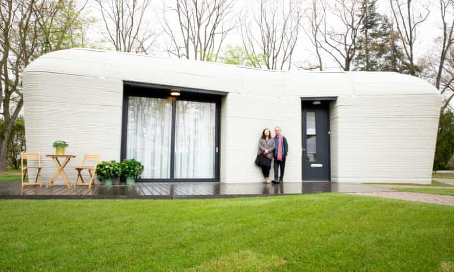 Harrie Dekkers and Elize Lutz outside their 3D-printed house in Eindhoven, the Netherlands.