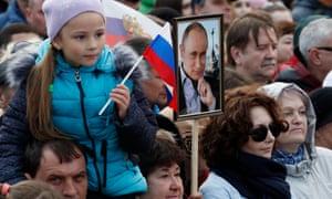 Putin supporters attend a rally celebrating the fourth anniversary of Russia's annexation of Crimea in Sevastopol, Republic of Crimea, Russia.