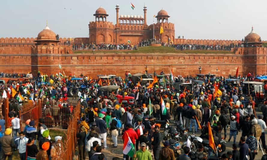 Farmers gather in front of the historic Red Fort during a protest against new farm laws.