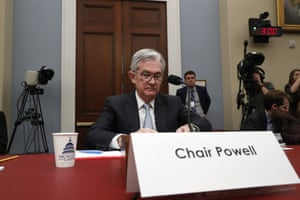 Fed Chair Jerome Powell takes his seat to testify to the House Budget Committee.