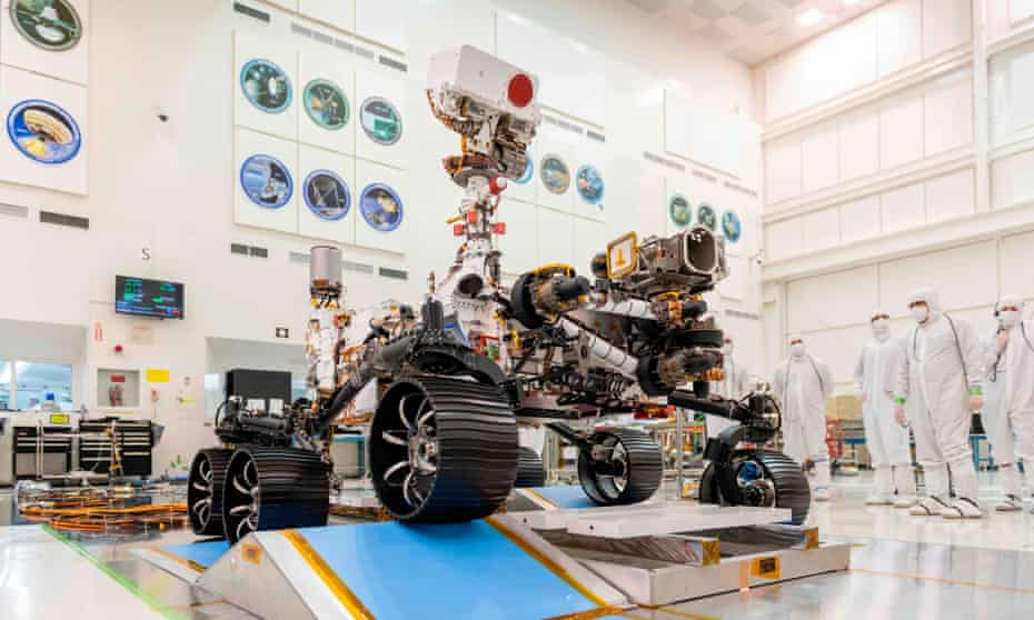 Engineers in Nasa's jet propulsion laboratory in Pasadena, California with the Perseverance rover in 2019.