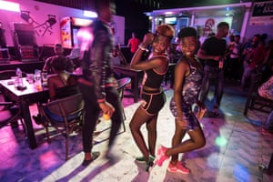 People drink, chat and dance to kizomba music