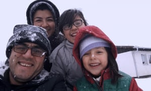 Hassan Fazili and family in Midnight Traveler