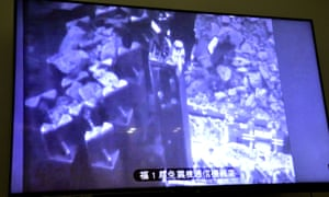 A monitor shows the operation in the No.3 reactor building at Fukushima Daiichi nuclear power plant