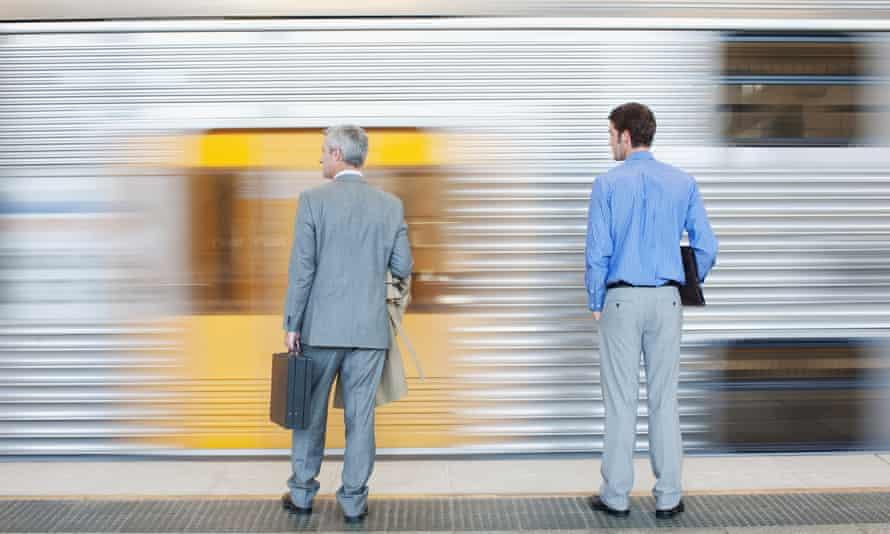 Businessmen watching a speeding train