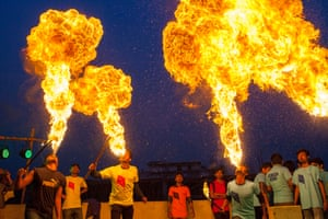 Dhaka, Bangladesh<br>Young men compete at fire splitting as they celebrate the Shakrain or Kite festival, one of the oldest, famous and important annual festivals that takes place in Bangladesh