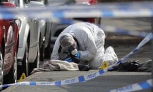 Forensic police photograph the crime scene in Birstall.