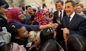 David Cameron and Nicolas Sarkozy are greeted by Libyans in 2011